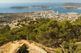 Mountain biking Mont Faron with a view on the bay of Toulon, French Riviera.