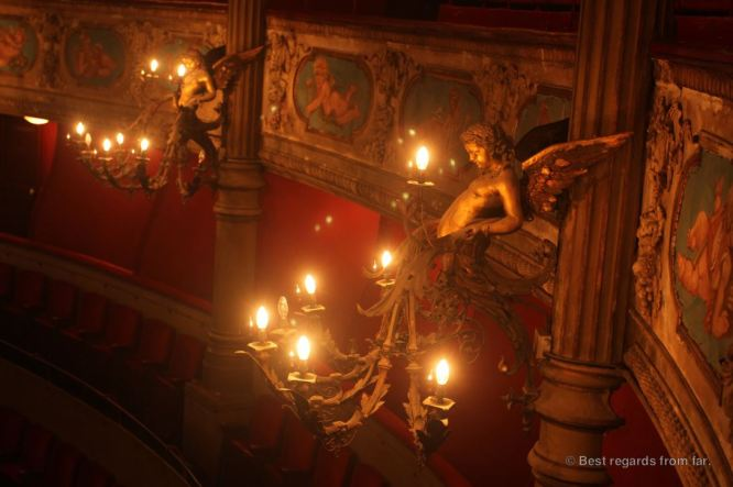 Angel holding the light in the opera house of Toulon, French Riviera