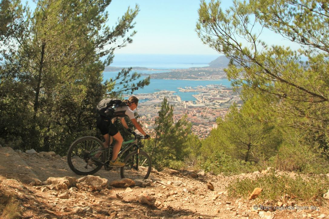 Mountain biking down the Mont Faron with a view on the bay of Toulon, France.