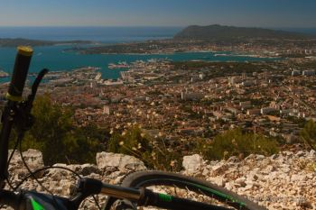Taking in the view on Toulon and the Côte d'Azur before biking downhill, France.