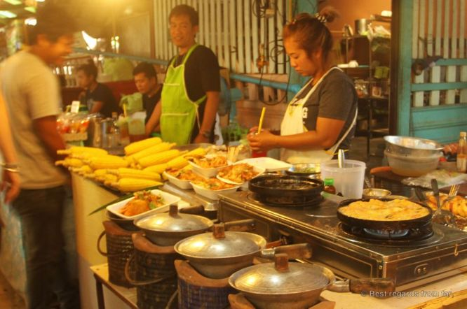 Cooking at the Khlong Lat Mayom market, Bangkok, Thailand