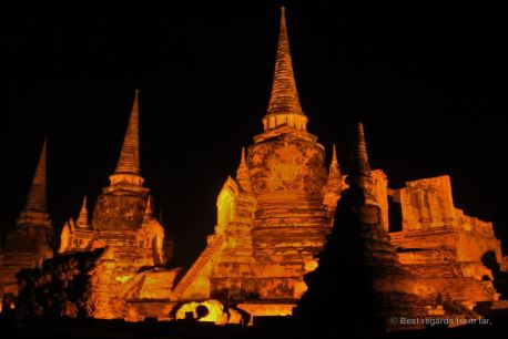 The lit ruins of Wat Ratchuburana, Ayutthaya, Thailand