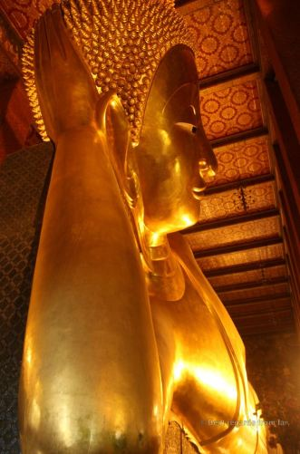 The 2.5-metre wide face of the reclining buddha, Wat Pho, Bangkok