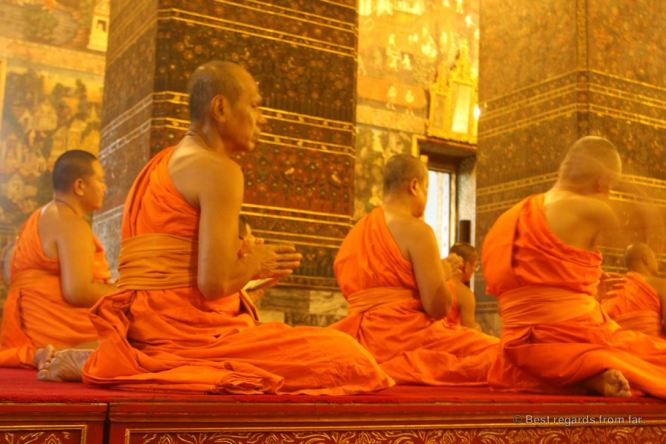 Monks chanting for the evening prayer in the ordination hall (Phra Ubosot), Wat Pho, Bangkok