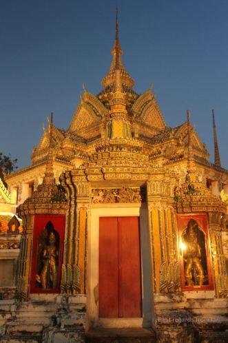 Figures of giants guarding Phra Mondop, the scripture hall, Wat Pho, Bangkok