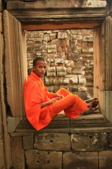 Young Buddhist monk at Angkor's Baphuon temple, Cambodia