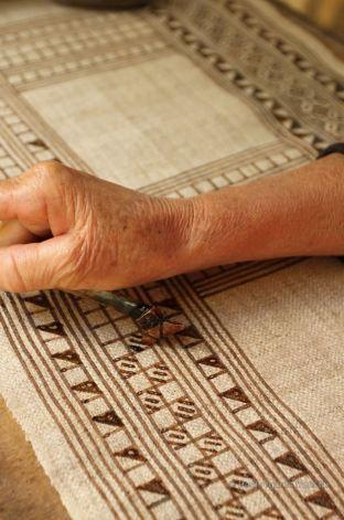 Applying the wax on the Hmong batik, Laos