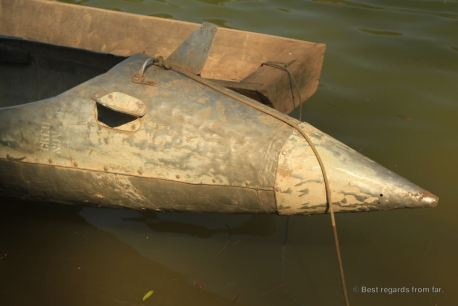 Fuel tanks recycled as bomb boats during the secret war in Laos Ban. Photo of the tip of a bomb boat on the river in Thabak, Laos.