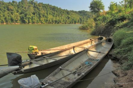 Fuel tanks recycled as bomb boats during the secret war in Laos Ban. Photo taken on the river in Thabak, Laos.
