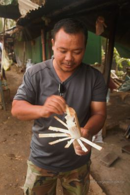 Mr. Ola showing how to peel the bamboo sticky rice, Battambang, Cambodia
