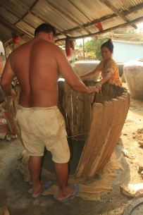 It takes two to build the mold for the water jar, Battambang, Cambodia