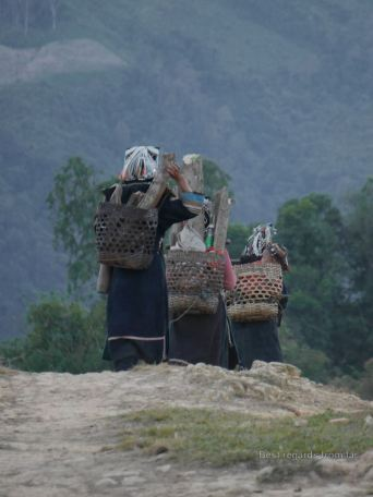 Women going home after working the fields, Akha village trekking, Laos