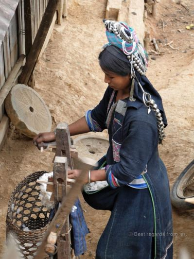 Akha woman processing cotton, Akha village trek, Laos