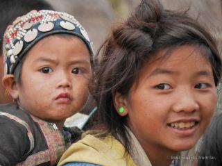 Young boy wearing traditional rare Akha clothes, Akha village trekking, Laos