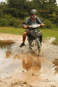 Dragging the Honda Dream through the puddle, Beng Mealea, Cambodia
