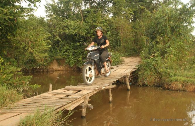 Crossing the tricky bridge on our way to Beng Mealea, Cambodia