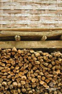 Firewood underneath a bamboo woven house, Ban Hoy Seen, Laos