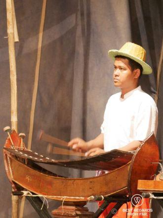 Focused musician during a show at the Phare Ponleu Selpak circus in Battambang, Cambodia