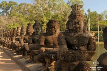 The demons holding the naga on the bridge to the south entrance gate of Angkor Thom, Angkor, Cambodia