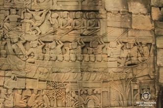 A naval battle at the top, and a market scene at the bottom of a Bayon bas relief, Angkor, Cambodia