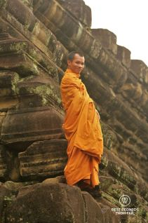 A monk on Baphuon temple, Angkor, Cambodia