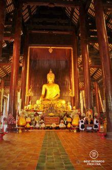 Sacred Buddha inside Wat Phan Tao, Chiang Mai, Thailand