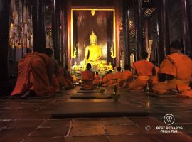 Prayer at Wat Phan Tao, Chiang Mai, Thailand