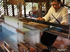 Weaving the golden silk on the loom, Siem Reap, Cambodia