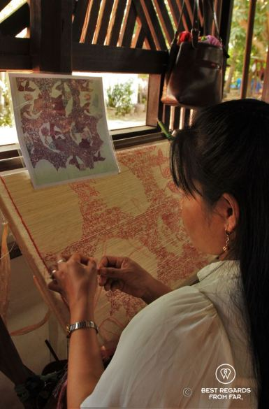 Wrapping the golden silk to prepare it for the dyeing, Siem Reap, Cambodia