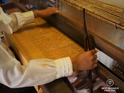 Weaving the pre-dyed golden silk on the loom, Siem Reap, Cambodia