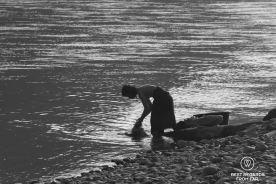 Woman washing in the Nam Ou River, Laos