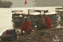 Monks waiting by the boat landing, Muang Khua, Laos