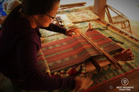Traditional weaving with a foot loom in Laos