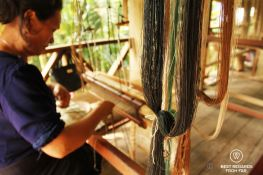 Traditional weaving with on a loom in Laos