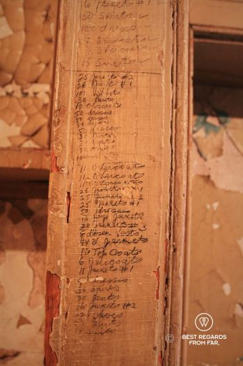 Cloth inventory of a garment district worker on the wall at the Tenement Museum, New York City