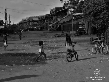 Kids playing in the street of Kampong Phluk, floating village, Tonlé Sap, Cambodia