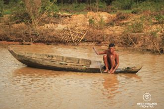 Fisherman in Kampong Phluk floating village, Tonlé Sap, Cambodia