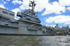 Training along the Intrepid Museum before kayaking the Statue of Liberty, New York City