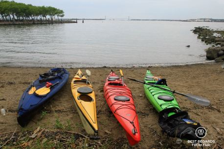 Lunch break while kayaking to the Statue of Liberty with the Verrazano Bridge in the background, New York City