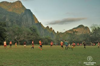 A soccer game in the stunning setting of Vang Vieng, Laos