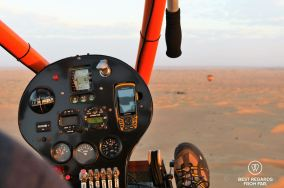 Paramotoring at sunrise over the desert of Dubai, UAE
