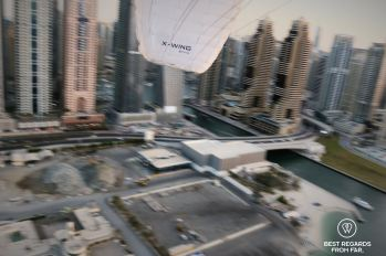 Acrobatics before landing the paramotor, Dubai, UAE