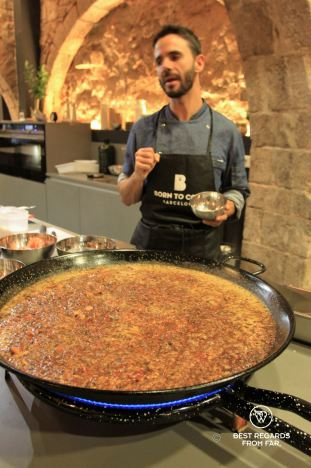 Preparing the paella at Born to cook cooking school, Barcelona