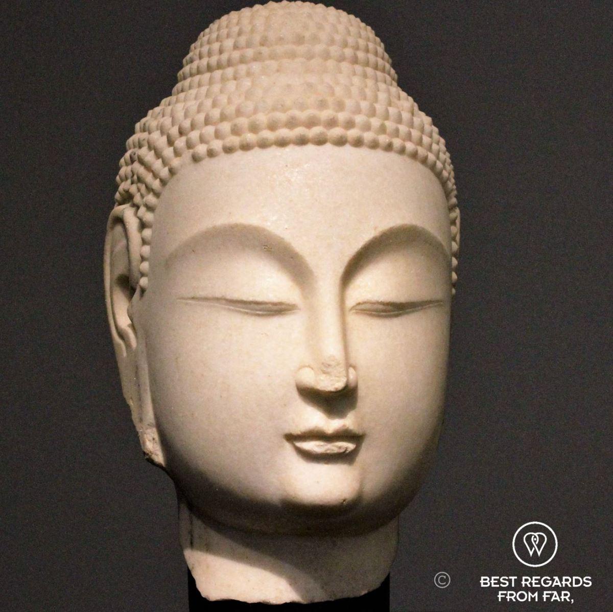 Statue of a white Buddha head, Northern China, 530-580, Louvre Abu Dhabi, UAE.