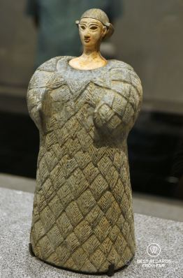 Small statue of a woman dressed in a woollen garment. Louvre Abu Dhabi, UAE
