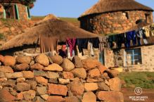 Traditional village with rondavels and drying laundry, Lesotho