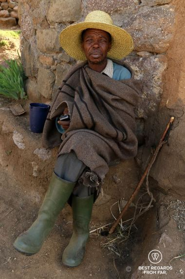 Portrait of an old Basotho man in traditional cloth at his rondavel, Lesotho