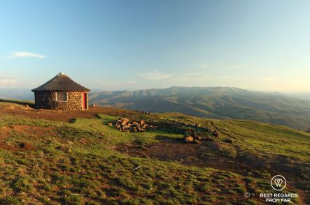 Traditional Basotho rondavel overlooking the mountains, Lesotho.