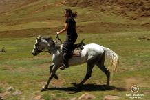 Writer Claire Lessiau horseback riding in Lesotho.