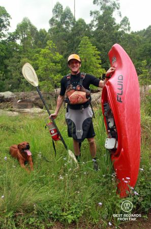 Kestell and his rescue dog from Kestell Adventures ready to provide kayaking support to the geckos at the Sabie River, South Africa
